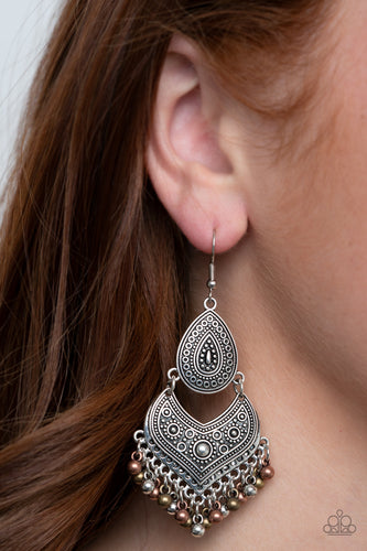 Studded and embossed in tribal inspired patterns, an antiqued silver teardrop links with a decorative silver frame. Dainty copper, brass, and silver beads swing from the bottom of the stacked lure, creating a musical fringe. Earring attaches to a standard fishhook fitting.  Sold as one pair of earrings.   Always nickel and lead free.