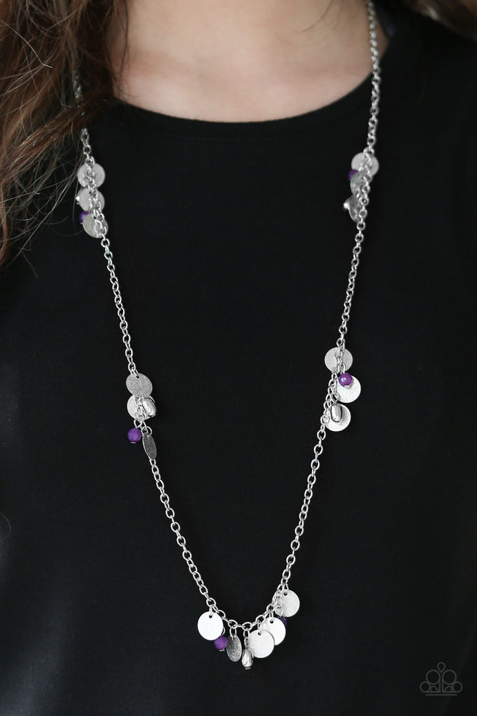 Delicately hammered in blinding shimmer, glittery silver discs join purple crystal-like beading along a shiny silver chain for a whimsical look. Features an adjustable clasp closure.  Sold as one individual necklace. Includes one pair of matching earrings.  Always nickel and lead free.