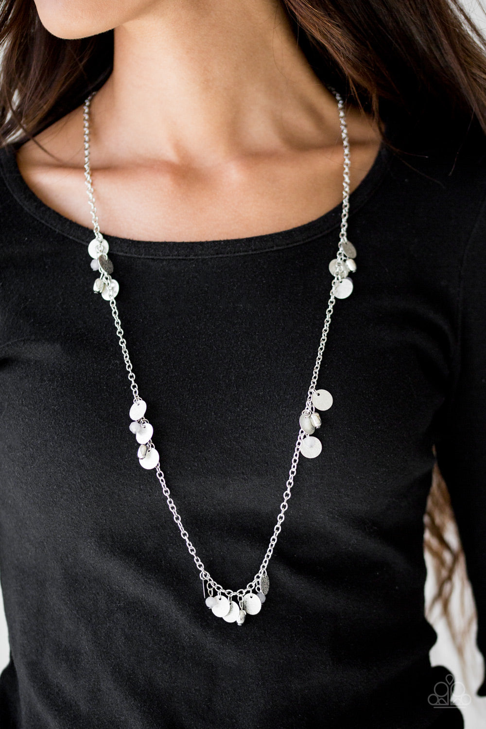 Delicately hammered in blinding shimmer, glittery silver discs join gray crystal-like beading along a shiny silver chain for a whimsical look. Features an adjustable clasp closure.  Sold as one individual necklace. Includes one pair of matching earrings.  Always nickel and lead free.