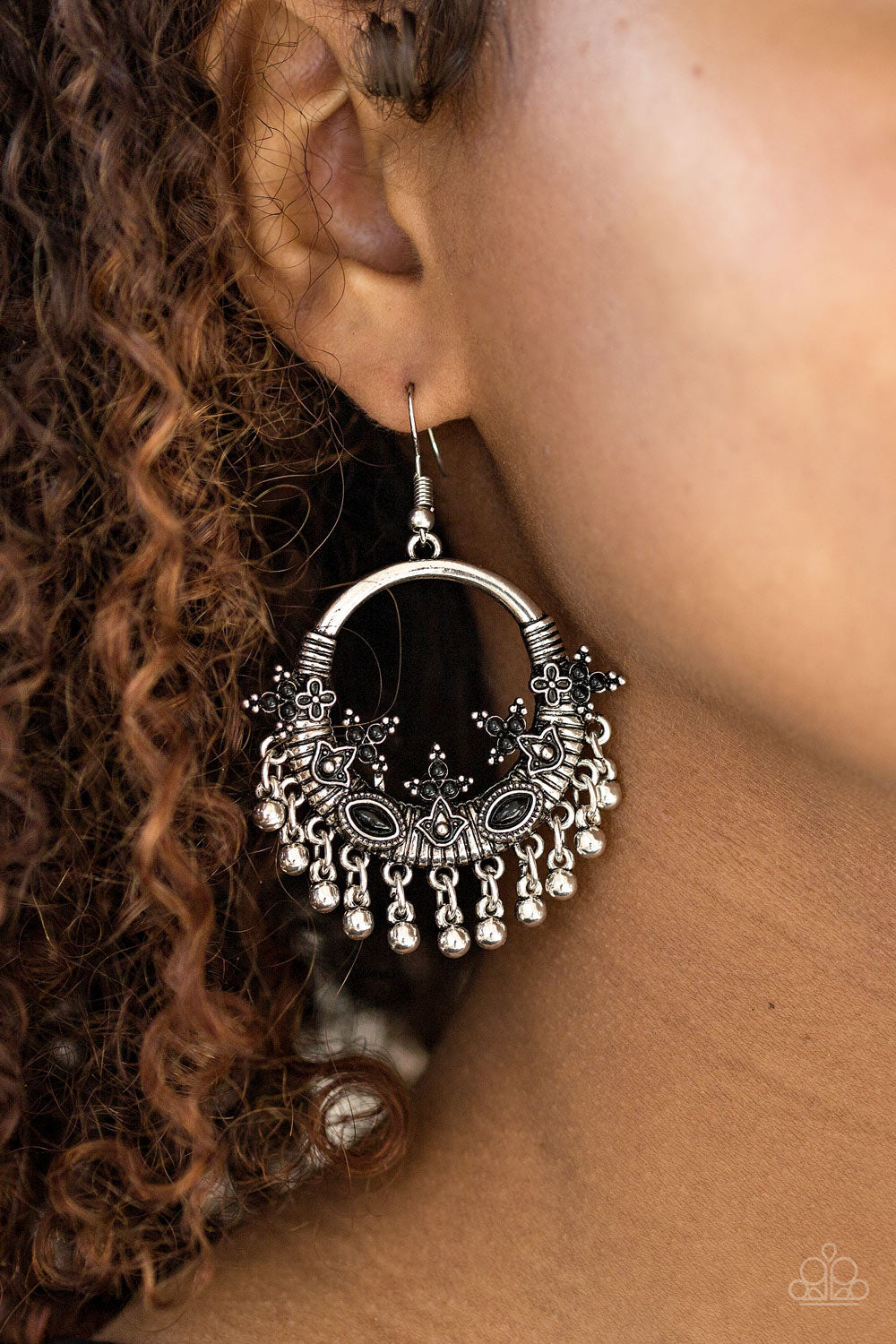 Dainty black beads are sprinkled along ornate frames that have been pressed into the bottom of a textured silver hoop. Imperfect silver beads swing from the bottom of the seasonal frame, creating a whimsical fringe. Earring attaches to a standard fishhook fitting.  Sold as one pair of earrings.  Always nickel and lead free.
