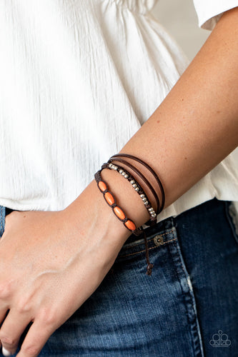 Infused with dainty silver and refreshing orange stone beads, mismatched strands of braided twine-like cord and brown leather pieces delicately layer across the wrist for a colorfully earthy look. Features an adjustable sliding knot closure.  Sold as one individual bracelet.  Always nickel and lead free.