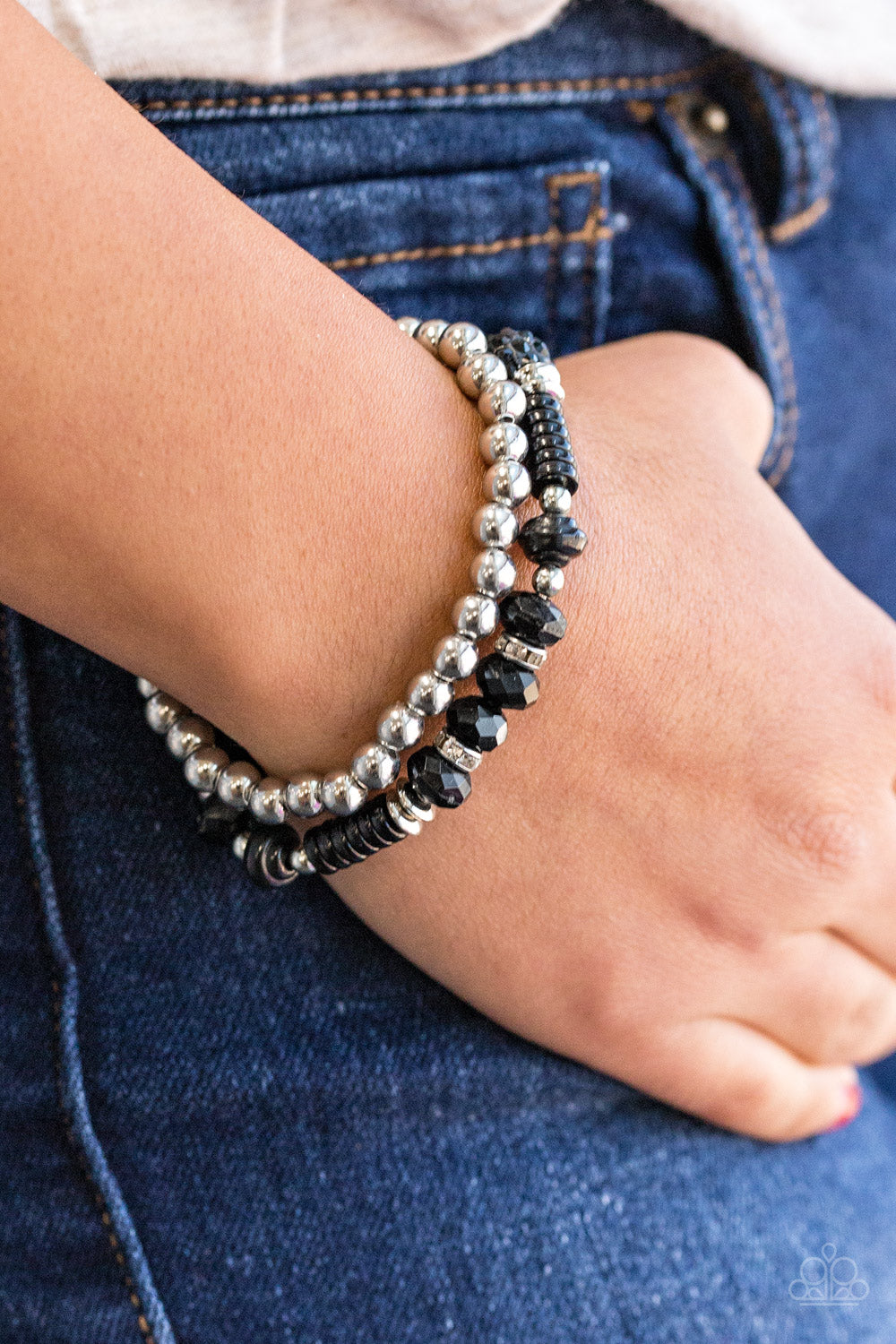 A classic strand of silver beading joins with a strand of beautiful black beading. Infused with crystal like beading, rings and beads encrusted in dazzling white and black rhinestones are sprinkled along the colorful band for a whimsical finish.  Sold as one set of two bracelets  Always nickel and lead free.