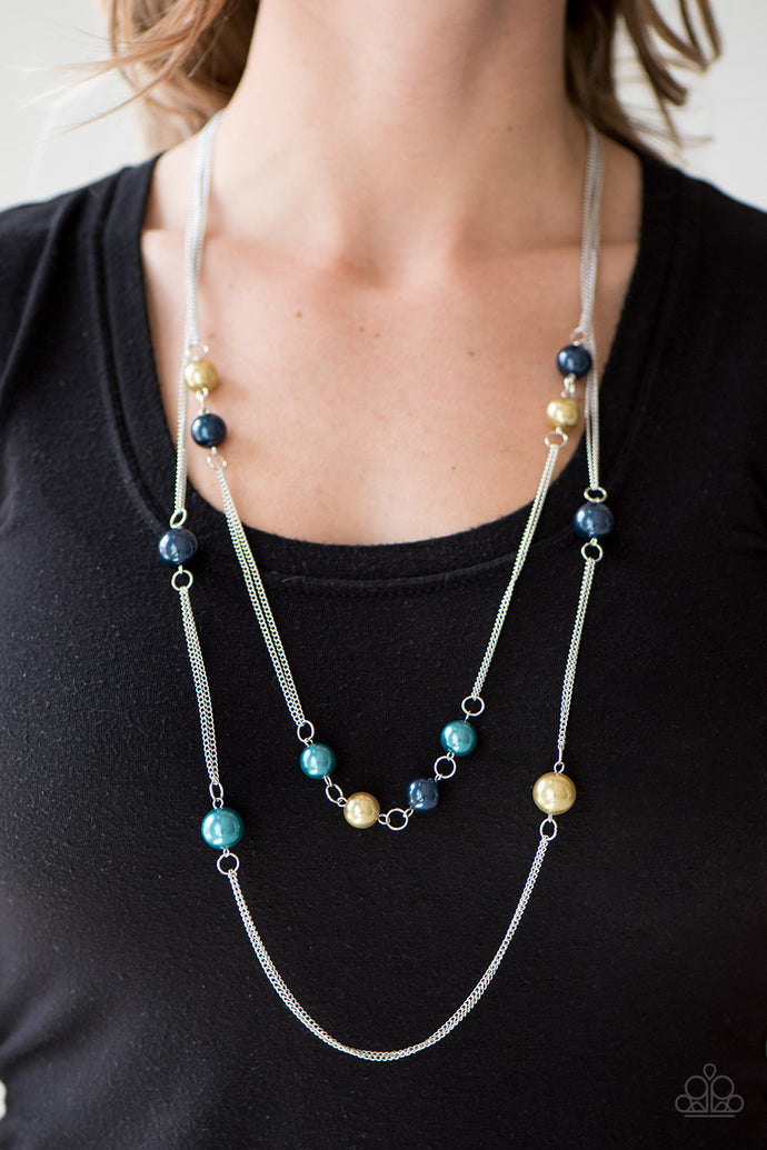 Colorful pearls trickle along doubled strands of glistening silver chain, creating refined layers across the chest. Features an adjustable clasp closure.  Sold as one individual necklace. Includes one pair of matching earrings.  Always nickel and lead free.