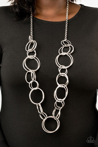 Pairs of dramatically oversized silver hoops connect across the chest, creating an elegantly elongated statement piece for a fearless look. Features an adjustable clasp closure.  Sold as one individual necklace. Includes one pair of matching earrings.  Always nickel and lead free.