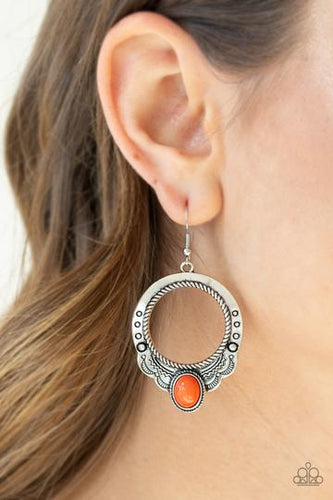 An oval orange stone is pressed into the bottom of a scalloped silver hoop stamped and studded in trendy patterns for a southwestern inspired look. Earring attaches to a standard fishhook fitting.  Sold as one pair of earrings.  Always nickel and lead free.