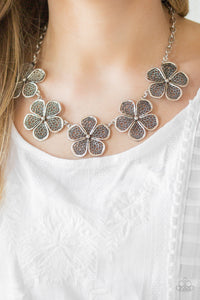Featuring lace-like petals, glistening silver daisies link below the collar for a seasonal look. Features an adjustable clasp closure.  Sold as one individual necklace. Includes one pair of matching earrings.  Always nickel and lead free.