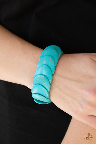 Overlapping turquoise stones are threaded along stretchy bands around the wrist for an artisan inspired look.  Sold as one individual bracelet.  Always nickel and lead free.Overlapping turquoise stones are threaded along stretchy bands around the wrist for an artisan inspired look.  Sold as one individual bracelet.  Always nickel and lead free.
