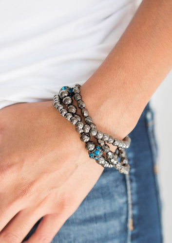 Mismatched gunmetal beads and blue rhinestone encrusted beads are threaded along stretchy bands for an edgy and refined look.  Sold as one set of three bracelets.  Always nickel and lead free.