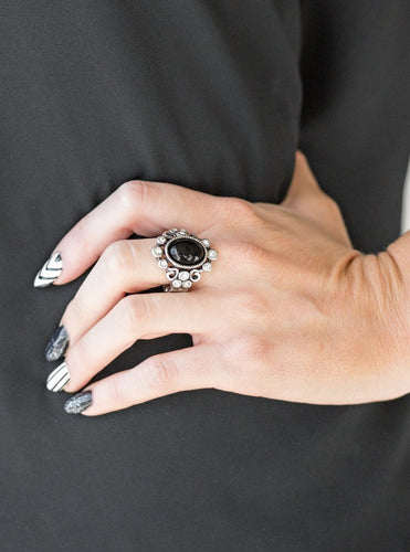 A polished black bead is pressed into a bubbly silver frame radiating with glassy white rhinestones for a notable finish. Features a stretchy band for a flexible fit.  Sold as one individual ring.  Always nickel and lead free.