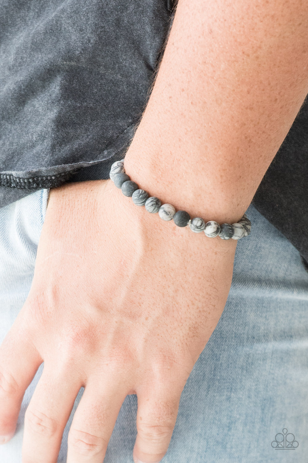 Swirling with dizzying detail, natural stones are threaded along a stretchy band for a seasonal look.  Sold as one individual bracelet.  Always nickel and lead free.