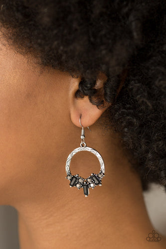 Featuring round and emerald style cuts, radiant hematite and black rhinestones are encrusted along the bottom of an ornate silver hoop for an edgy look. Earring attaches to a standard fishhook fitting.  Sold as one pair of earrings.  Always nickel and lead free.