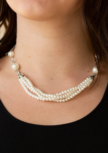 Oversized white pearls and crystal-like beads give way to layers of beaded pearl strands below the collar for a timeless look. Features an adjustable clasp closure.  Sold as one individual necklace. Includes one pair of matching earrings.  Always nickel and lead free.
