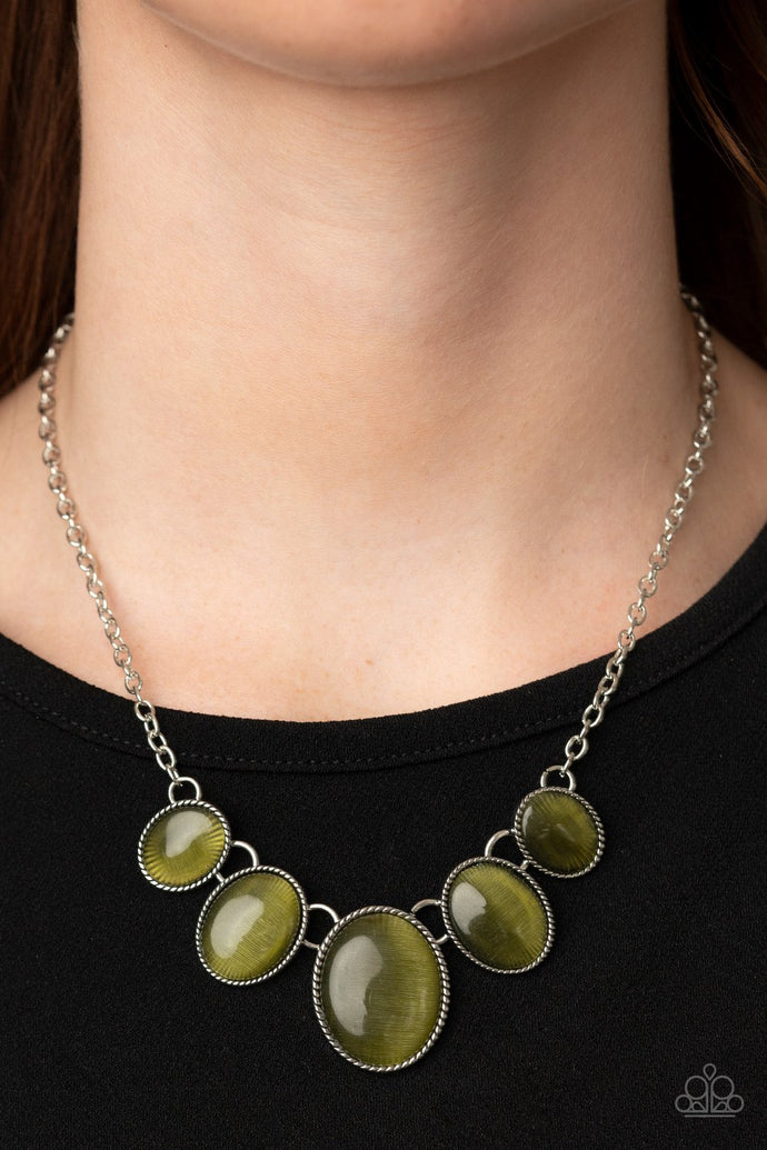 Gradually increasing in size, a dainty collection of glowing Military Olive cat's eye oval stones delicately link below the collar for a whimsical pop of color. Features an adjustable clasp closure.  Sold as one individual necklace. Includes one pair of matching earrings.   Always nickel and lead free.