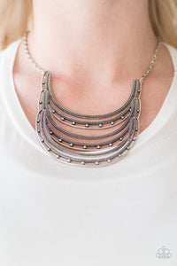 Studded in antiqued texture, three horse shoe shaped frames connect below the collar in a bold fashion. Features an adjustable clasp closure.  Sold as one individual necklace. Includes one pair of matching earrings.  Always nickel and lead free.