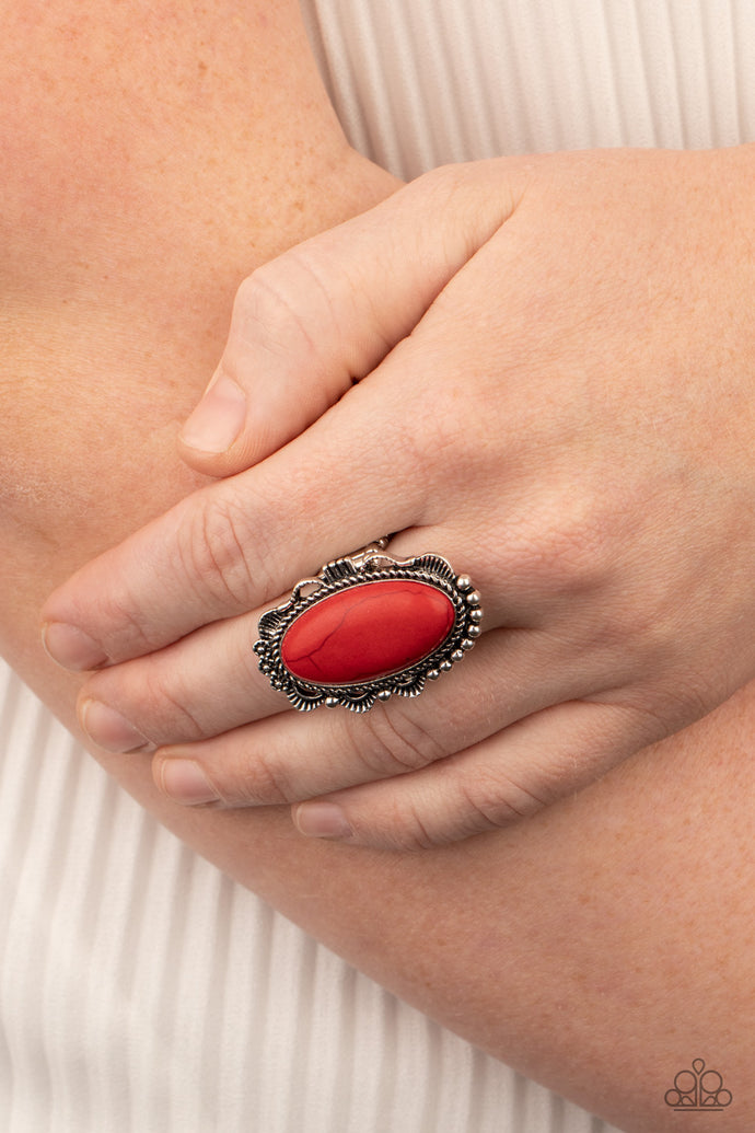 A fiery red stone is pressed into an ornate silver frame rippling with studded and serrated textures for a seasonal flair. Features a stretchy band for a flexible fit.  Sold as one individual ring.  Always nickel and lead free.