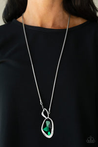 A faceted green gem is nestled inside of a shimmery silver frame encrusted in dainty white rhinestones. The glittery pendant asymmetrically links with abstract silver frames at the bottom of a lengthened silver rounded snake chain for a modern look. Features an adjustable clasp closure.  Sold as one individual necklace. Includes one pair of matching earrings..  Always nickel and lead free.