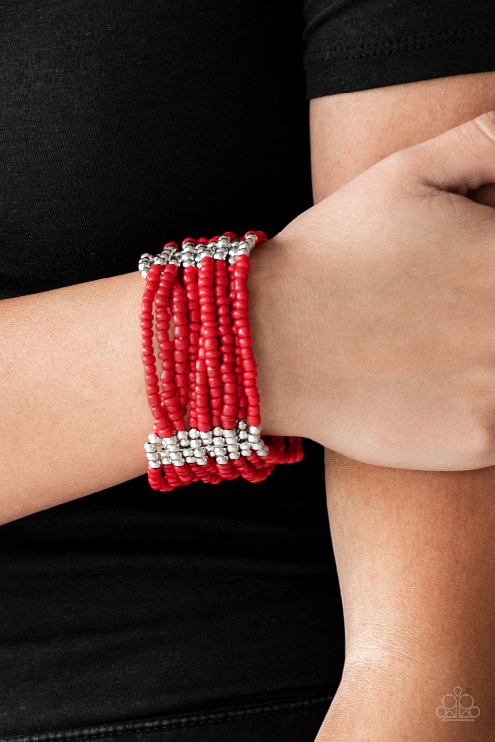Joined together with metallic fittings, countless red seed beads are threaded along stretchy elastic bands. Sections of dainty silver beads are sprinkled along the colorful layers, adding hints of shimmer to the seasonal palette.  Sold as one individual bracelet.  Always nickel and lead free.