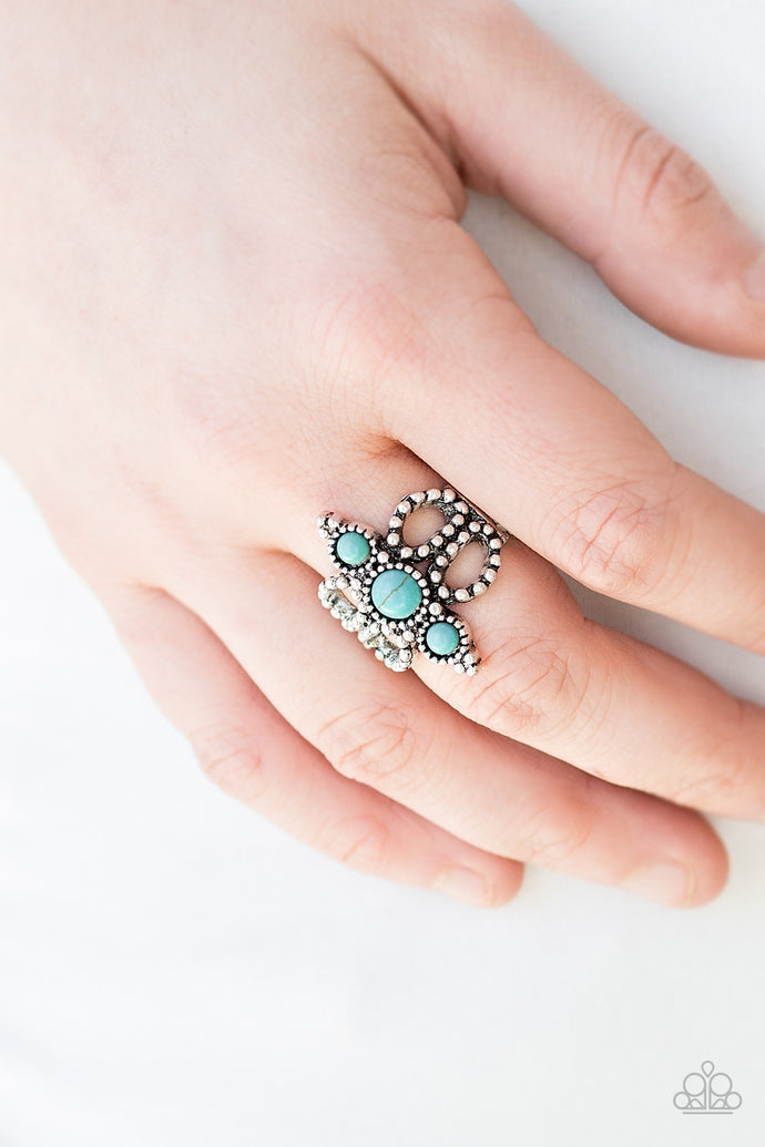 Dainty turquoise stones stack down the center of a frilly silver band radiating with studded textures. Features a stretchy band for a flexible fit.  Sold as one individual ring.  Always nickel and lead free.