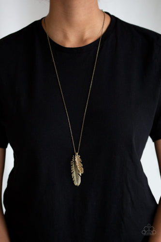 An aurum rhinestone encrusted brass feather joins a lifelike brass feather at the bottom of a lengthened brass chain, creating a whimsical pendant. Features an adjustable clasp closure.  Sold as one individual necklace. Includes one pair of matching earrings.  Always nickel and lead free.