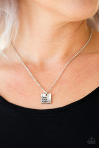 "Stamped in the inspirational phrase, ""own your journey,"" an antiqued silver plate swings below the collar for a whimsical fashion. Features an adjustable clasp closure.  Sold as one individual necklace. Includes one pair of matching earrings.   Always nickel and lead free."