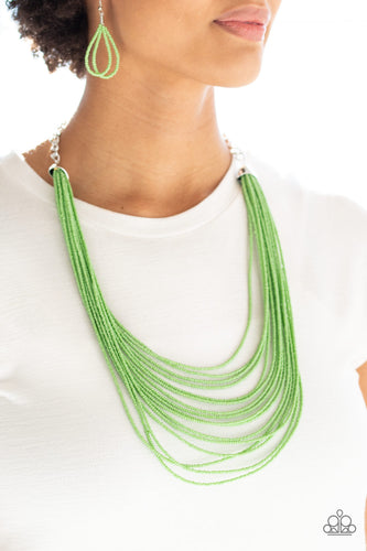 Infused with two bold silver fittings, row after row of green seed beads layer across the chest for a seasonal fashion. Features an adjustable clasp closure.  Sold as one individual necklace. Includes one pair of matching earrings.  Always nickel and lead free.