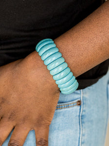 Refreshing turquoise stone beads are threaded along stretchy bands, creating an earthy look around the wrist.  Sold as one individual bracelet.  Always nickel and lead free.
