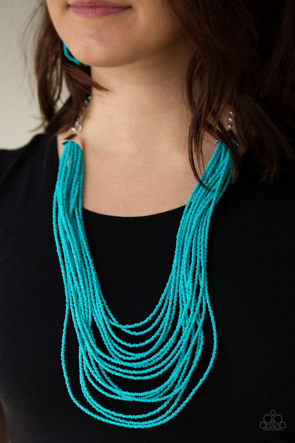 Infused with two bold silver fittings, row after row of turquoise seed beads layer across the chest for a seasonal fashion. Features an adjustable clasp closure.  Sold as one individual necklace. Includes one pair of matching earrings.  Always nickel and lead free.