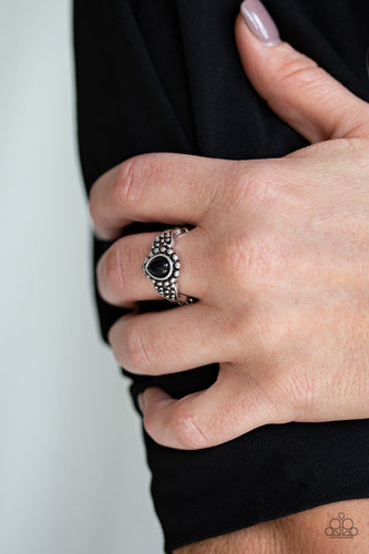 A teardrop black bead is pressed into the center of a dainty silver band radiating with studded patterns for a seasonal look. Features a dainty stretchy band for a flexible fit.  Sold as one individual ring.   Always nickel and lead free.  Item #P4WH-BKXX-079XX