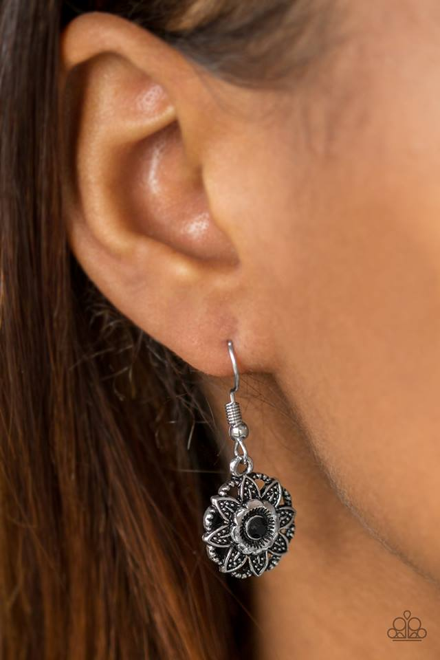 Textured silver leaves and shiny silver petals bloom from a dainty black rhinestone, creating a whimsical frame. Earring attaches to a standard fishhook fitting.  Sold as one pair of earrings.  Always nickel and lead free.