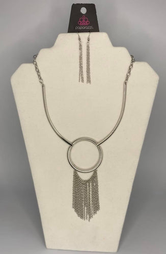 Attached to two bowing shiny silver bars, a shiny silver hoop gives way to a matching chain fringe, creating a statement-making look below the collar. Features an adjustable clasp closure.  Sold as one individual necklace. Includes one pair of matching earrings.  Always nickel and lead free.  Fashion Fix February 2021 Exclusive