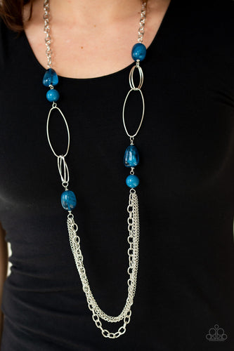 Featuring polished and cloudy faux rock finishes, blue beads link with bold silver hoops. The whimsical compilation gives way to layers of mismatched silver chains for a seasonal finish. Features an adjustable clasp closure.  Sold as one individual necklace. Includes one pair of matching earrings.   Always nickel and lead free.