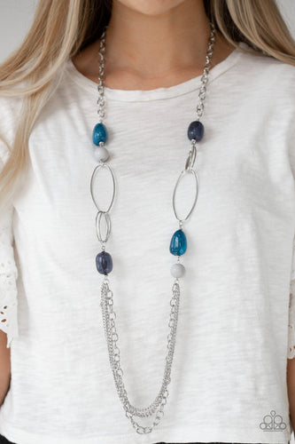 Featuring polished and cloudy faux rock finishes, gray and blue beads link with bold silver hoops. The whimsical compilation gives way to layers of mismatched silver chains for a seasonal finish. Features an adjustable clasp closure.  Sold as one individual necklace. Includes one pair of matching earrings.  Always nickel and lead free.