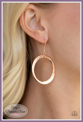 Delicately hammered in light-catching detail, an asymmetrical rose gold hoop swings from the ear for an artisan inspired look. Earring attaches to a standard fishhook fitting.  Sold as one pair of earrings.   By Paparazzi Accessories.  Always nickel and lead free.