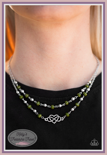 Faceted green and shiny silver beads trickle along two strands of shimmery silver chain, creating colorful layers beneath the collar. A shimmery silver infinity charm loops through a shimmery heart, creating a whimsical centerpiece.  Sold as one individual necklace. Includes one pair of matching earrings.  Always nickel and lead free.
