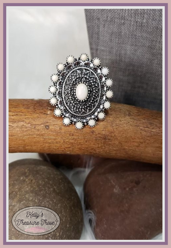 Smooth white stones are pressed into a glistening silver frame radiating into a mandala detail for an inspired look. Features a stretchy band for a flexible fit.  Sold as one individual ring.  Always nickel and lead free  Fashion Fix Exclusive April 2020