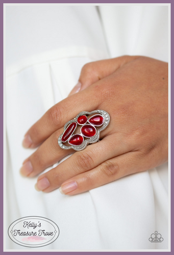 Dotted in sections of dainty white rhinestones, a studded silver ribbon waves around a collection of red cat's eye stones for a refined flair. Features a stretchy band for a flexible fit.  Sold as one individual ring.  By Paparazzi Accessories.  Always nickel and lead free.