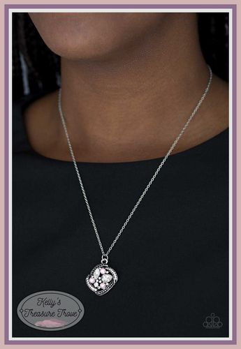 Alternating in silver studs and glassy white rhinestones, dainty silver bars fold around a sparkling mishmash of glassy white rhinestones and dainty pink pearls. The sparkling pendant swings below the collar for a timeless look. Features an adjustable clasp closure.  Sold as one individual necklace. Includes one pair of matching earrings. Always nickel and lead free.