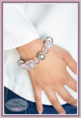 Infused with mismatched silver beads, a collection of opaque, polished, pearly, and crystal-like gray beads are threaded along a stretchy band around the wrist for a whimsical look.  Sold as one individual bracelet.  Always nickel and lead free.