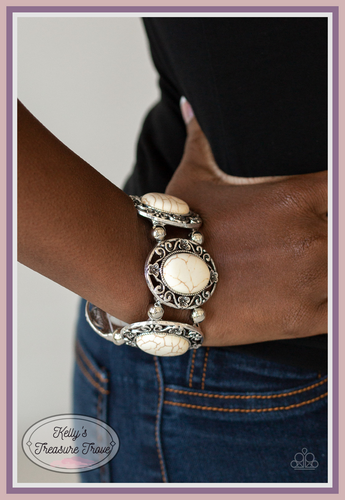 Featuring refreshing white stone centers, a collection of shimmery silver floral frames are threaded along a stretchy band around the wrist for a seasonal flair.  Sold as one individual bracelet.