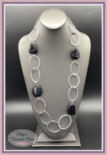 Featuring a faux rock finish, faceted black beads join hammered silver hoops across the chest for a seasonal look. Features an adjustable clasp closure.  Sold as one individual necklace. Includes one pair of matching earrings  Always nickel and lead free.