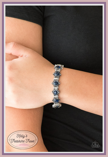 Featuring glittery blue rhinestone centers, ornate silver frames are threaded along stretchy bands, linking across the wrist for a refined look.  Sold as one individual bracelet.   Always nickel and lead free.