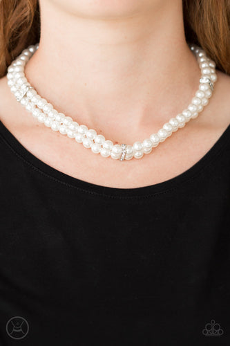 Pinched between white rhinestone encrusted frames, strands of classic white pearls layer around the neck for a timeless look. Features an adjustable clasp closure.  Sold as one individual necklace. Includes one pair of matching earrings.  Always nickel and lead free.