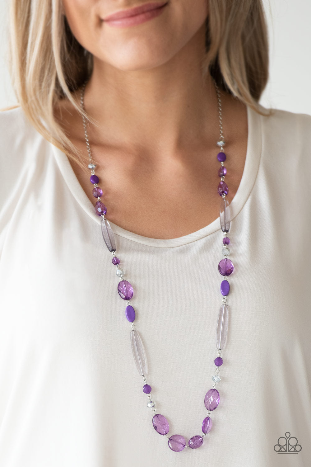 Varying in shape and shimmer, faceted purple and metallic crystal-like beads trickle down the chest for a whimsical look. Features an adjustable clasp closure.  Sold as one individual necklace. Includes one pair of matching earrings.  Always nickel and lead free.