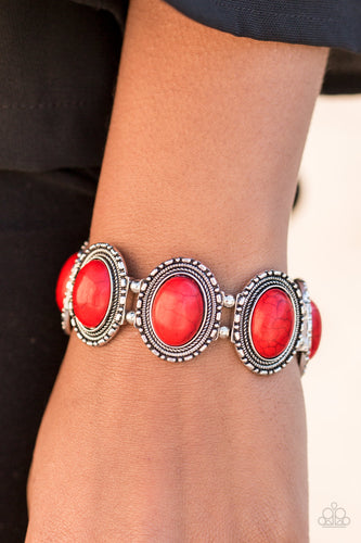 Smooth red stones are pressed into antiqued silver frames. Threaded along stretchy elastic bands, the earthy frames link around the wrist in a seasonal southwestern fashion.  Sold as one individual bracelet.  Always nickel and lead free.