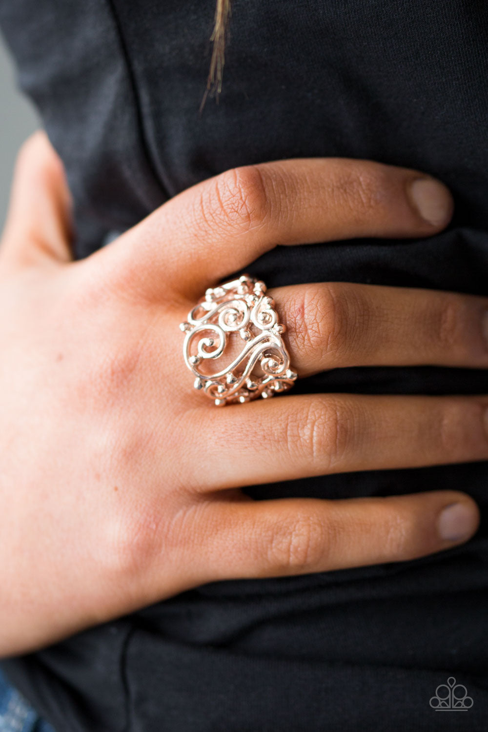 Glistening rose gold bars swirl across the finger, creating airy filigree. Shiny rose gold studs are sprinkled across the frilly pattern, adding tactile shimmer to the regal pattern. Features a stretchy band for a flexible fit.   Sold as one individual ring.   Always nickel and lead free.