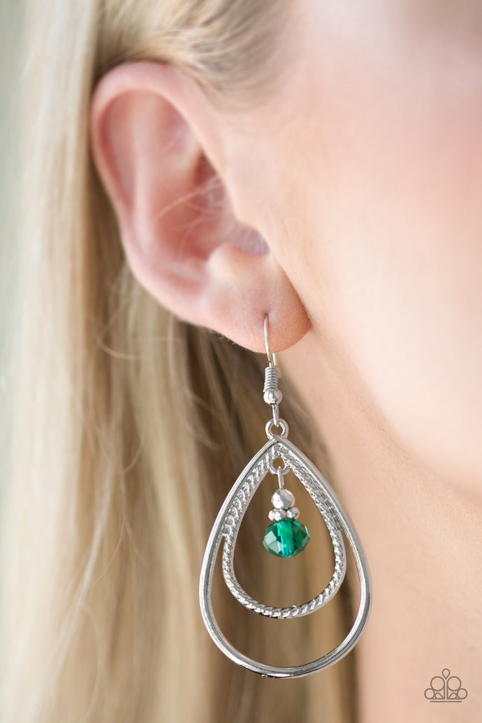 A green crystal-like bead swings from the top of a double teardrop frame radiating with smooth and rope-like textures for a refined look. Earring attaches to a standard fishhook fitting.  Sold as one pair of earrings.  Always nickel and lead free.