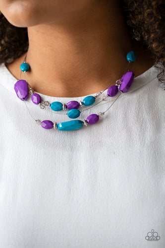 Infused with dainty metallic accents, a collection of faceted blue, purple, and sparkling crystal-like beads are threaded along invisible wires below the collar for a whimsically layered look. Features an adjustable clasp closure.  Sold as one individual necklace. Includes one pair of matching earrings.  Always nickel and lead free.