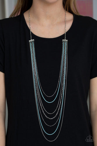 Mismatched silver chains alternate with dainty blue chains down the chest, creating a colorful industrial look. Features an adjustable clasp closure.  Sold as one individual necklace. Includes one pair of matching earrings.  Always nickel and lead free.