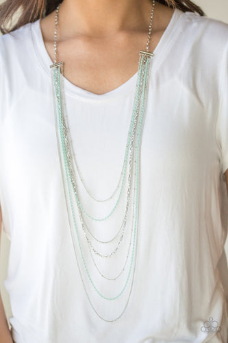 Mismatched silver chains alternate with dainty green chains down the chest, creating a colorful industrial look. Features an adjustable clasp closure.  Sold as one individual necklace. Includes one pair of matching earrings.  Always nickel and lead free.
