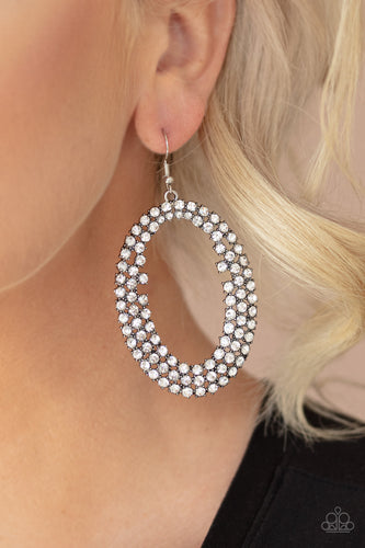 Row after row of glittery white rhinestones encircle into an oversized hoop, creating a gritty glamorous look. Earring attaches to a standard fishhook fitting.  Sold as one pair of earrings.  Always nickel and lead free.  Life of the Party June 2020